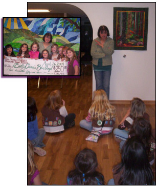 Betty receives a check for $250 from a local Brownie troop, March 26, 2009